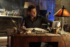 Henry sitting at his desk - Forever