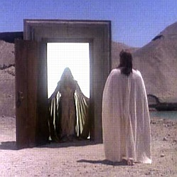 Nick confronts his Guide figure at the gateway between life and death