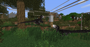 Two deinonychus playing with a scratching post.