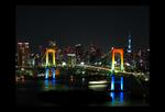 Rainbow colored Rainbow Bridge at night.