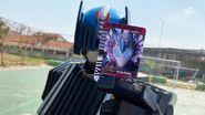 Kamen Rider Diend is holding his Kamen Ride Vulcan Card