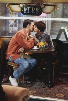 Chandler and Kathy kiss at coffeehouse.jpg