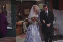 Phoebe and Chandler walking her down the aisel
