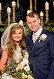 Joe and Kendra on their wedding day, People magazine watermark in top left corner