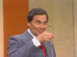Gene Rayburn Stares at His Microphone