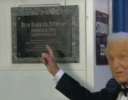 Bob Barker pointing to his plaque