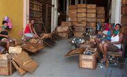 Women cleaning gas masks in a factory in Santiago de Cuba