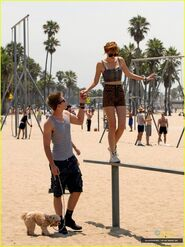 Bella-thorne-standing-on-wood-with-boyfriend-and-pooch