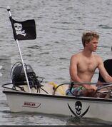 Kenton-duty-on-a-boat-shirtless