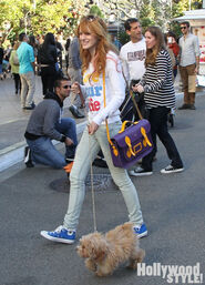 Bella-thorne-in-town-square-withpuppy