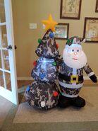 Gemmy inflatable camaflouge Santa and tree