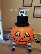 Gemmy inflatable ghost behind pumpkin spider