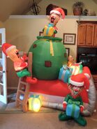 Gemmy inflatable elves with sleigh