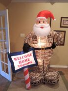 Gemmy inflatable military Santa with sign