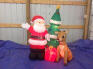 Gemmy inflatable santa with rudolph and tree