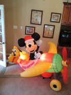Gemmy inflatable Mickey Mouse in Christmas plane
