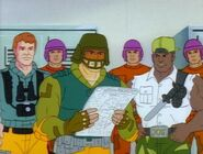 Grid-Iron Reading Newspaper along Scoop, Heavy-Duty and the Joes Troops