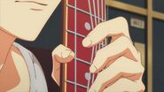 Mafuyu clutching his guitar strings