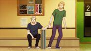 Akihiko grabbing Haruki's arm