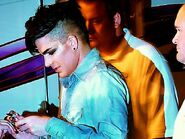 Adam Lambert signs autographs