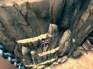 Kratos subiendo por las cornisas
