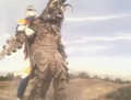 Godzilla vs. Megalon 10 - Jet Jaguar Holds Megalon