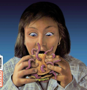 Regina eating a worm burger French cover-art