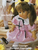 1986 MARSHA - Götz Elegance Play Doll - 16 Inch Soft-Bodied Doll with Jointed Arms and Legs - WEICHGELENKPUPPE 30062 - Brown Hair, Brown Eyes - Striped Pink Dress