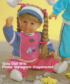 1986 PENNY - Gotz Modell Play Doll - 20 Inch Soft-Bodied Doll with Jointed Arms and Legs - WEICHGELENKBABY 36068 - Blonde Hair - Blue Eyes - Pink and Purple Jumper with White Trim and Sailboat