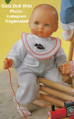 1986 BRITTA - Gotz Modell Play Doll - 16 Inch Soft-Bodied Baby Doll - WEICHBABY 27062 - Bald Baby Doll - Blue Eyes - Blue and White Striped Jumper