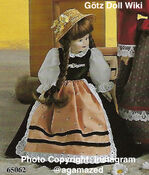 1986 MONICA - Götz Elegance Porcelain Play Doll - 14 Inch PORZELLANPUPPE 65062 - Brown Hair - Green and Peach Apron Dress