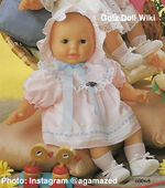1986 WENDY - Gotz Modell Play Doll - 22 Inch Soft-Bodied Baby Doll - WEICHBABY 60068 - Bald Baby Doll - Brown Eyes - Pink and White Gingham Dress with Blue Trim