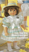 1986 FALLON - Gotz Modell Play Doll - 20 Inch Soft-Bodied Doll - WEICHPUPPE 09070 - Brown Hair, Brown Eyes - White Dress with Pastel Green and Yellow Stripes