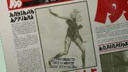 Kat in Newspaper