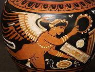 This beautiful and vibrant piece is a Greek Apulian lidded mug that dates circa 330 B.C Eros