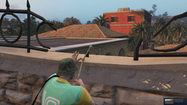 TheCayoPericoHeist-GTAO-CompoundEntry-GrapplingEquipment-SouthWall-Top
