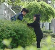 Jiajia helping Shen Wei out of bushes 2 cropped
