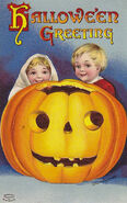 Boy and Girl Vintage Halloween Postcard