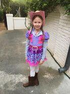 Natalya MacDonald-Risner as a cowgirl
