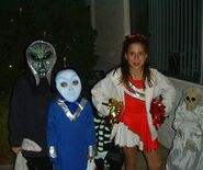 Aliens and a cheerleader, circa 2001