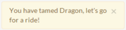 A pale yellow notification bubble reads: You have tamed Dragon, let's go for a ride!
