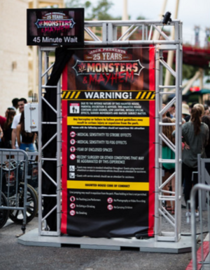 Jack Presents 25 Years of Monsters & Mayhem Sign Entrance.png