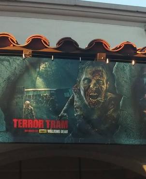 HHN 2014 Terror Tram The Walking Dead Front Gate Banner.png