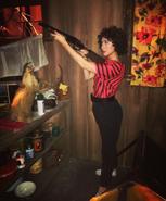 Nancy Wheeler holding a Shotgun