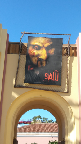HHN 27 SAW Front Gate Banner.png