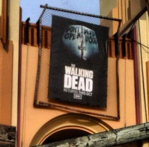 HHN 22 The Walking Dead Front Gate Banner.png