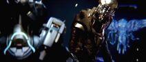 Thel Vadam Locke y un holograma H2A