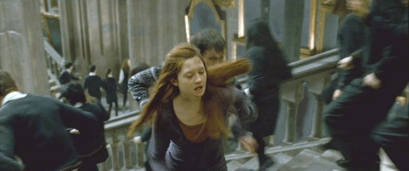 DH2 Ginny Weasley and other Hogwarts students running at the Staircase.jpg