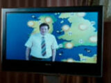 Unidentified TV weatherman