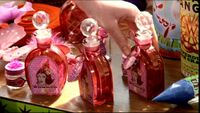 Bottles of Wonder Witch Love Potions (Weasleys' Wizard Wheezes product).JPG